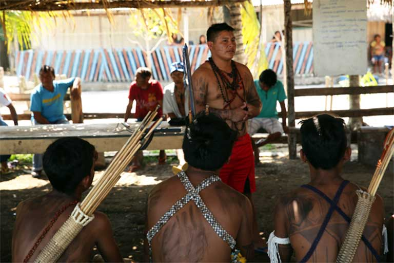 A meeting with the Munduruku in Teles Pires village. The Federal Police mistakenly assumed that one meeting was enough to gain agreement regarding the destruction of the gold mining barge, when really, according to Munduruku custom, it takes many meetings with all the members of the village before consensus can be reached. Photo by Mauricio Torres