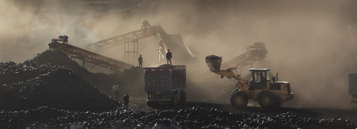 The Wujiata Open Pit Coal Mine near Ulan Moron, China, fills the air with coal dust. Photo by Qui Bo/Greenpeace.