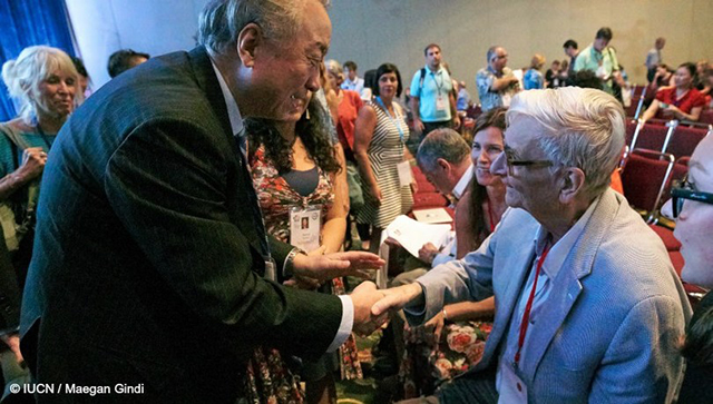 E.O. Wilson is greeted by President of the IUCN, Mr. Zhang Xinsheng, in Honolulu, September 2016. Image courtesy of IUCN.