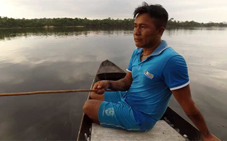 "Sandro Waro Munduruku: ""There are far fewer fish [in the Teles Pires River downstream from the dam now]. We never catch as many as we used to before the dam was built. Shoals of fish are dying. We don't know how we are going to live in the future."" Photo by Thais Borges"