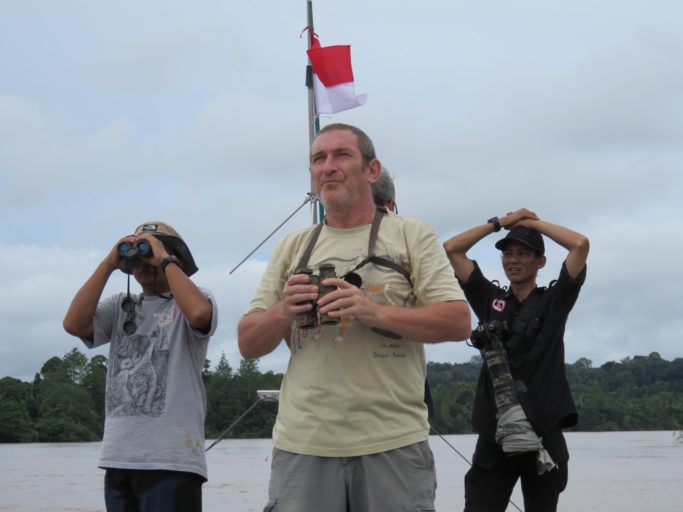I'd encourage others to come and visit the rivers of Borneo. Document what is happening. Write about it. And enjoy the still wonderful experience. Rustam, Graham and Arie looking for wildlife.