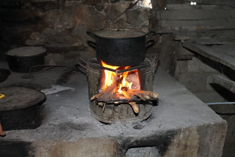 A tea kettle boils atop a TK90 stove provided by FFI Vietnam. Photo by Michael Tatarski for Mongabay