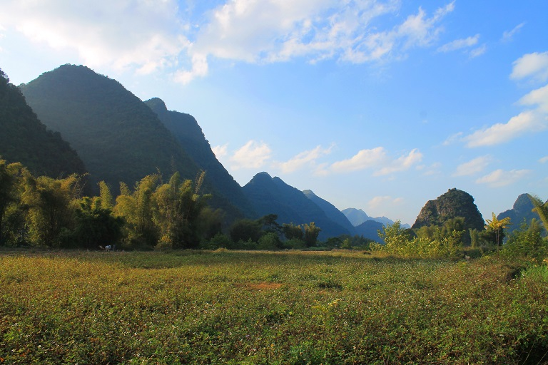 Agricultural land in Trung Khanh is limited to the flat land between jagged mountains. Photo by Michael Tatarski for Mongabay