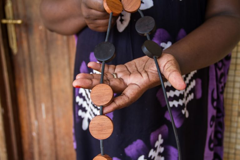 A necklace made from mpingo and another local hardwood. Mpingo's dark, lustrous properties has made it one of the most valuable timbers in the world. Photo by Sophie Tremblay for Mongabay