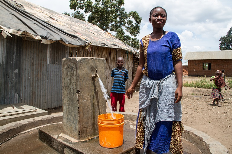 The village council has used profits from growing sales of mpingo to build several wells around the community so villagers, especially women, can easily access clean water and no longer need to travel long distances. Photo by Sophie Tremblay for Mongabay