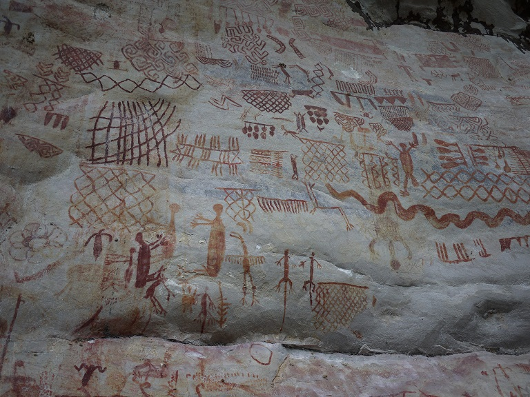 The Guaviare region is home to a number of these ancient murals, with paintings of animals, people, and sea creatures. One theory is they were painted by the indigenous people to point the way to the Chiribiquete National Park. Photo by Laura Dixon for Mongabay.