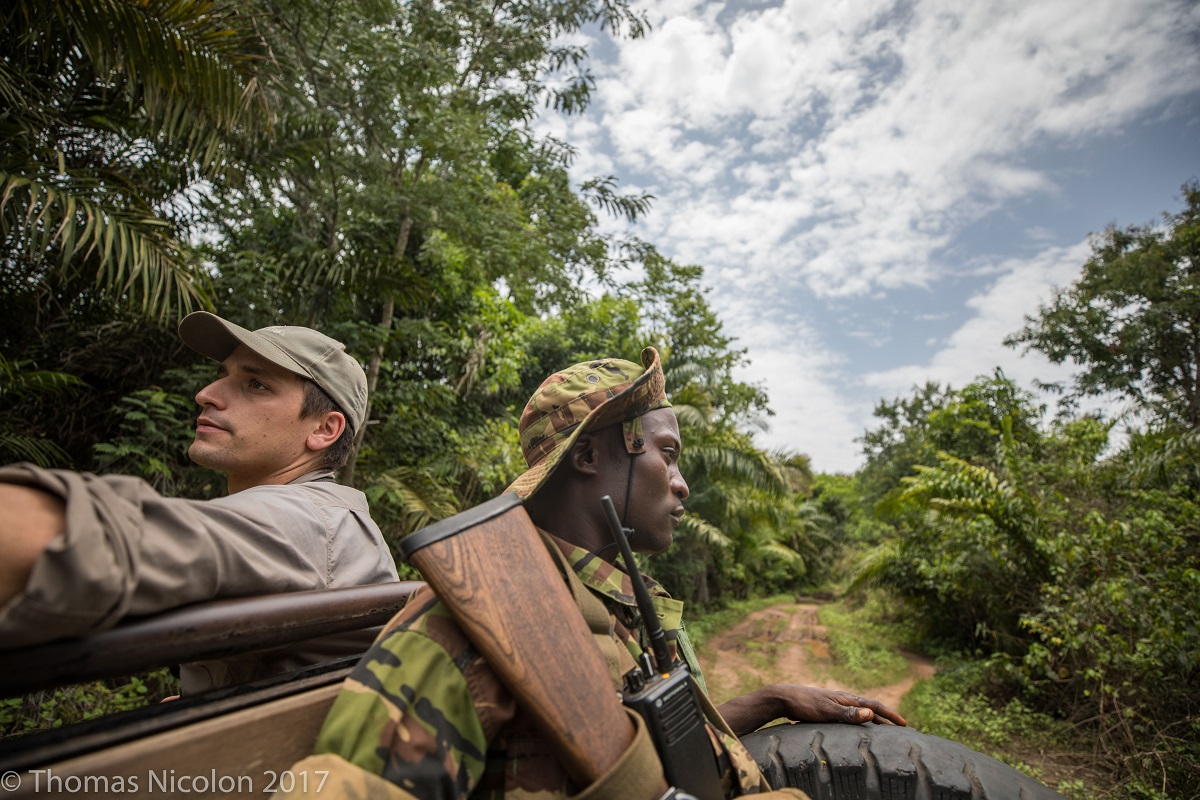 Scientist Mathias D'haen (l) rides through Garamba National Park with a ranger. Photo by Thomas Nicolon for Mongabay.