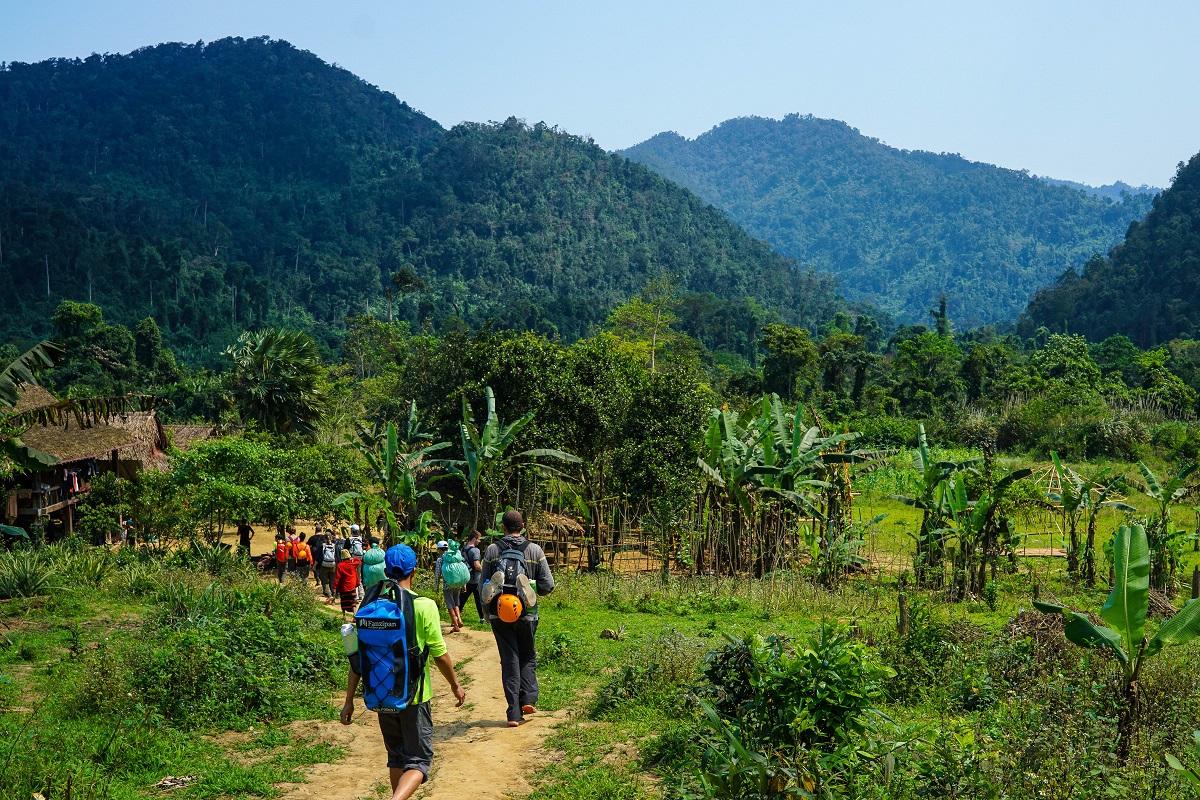 Hiking through the tiny village of Doong in central Vietnam's Phong Nha-Ke Bang National Park. Photo by Michael Tatarski for Mongabay.