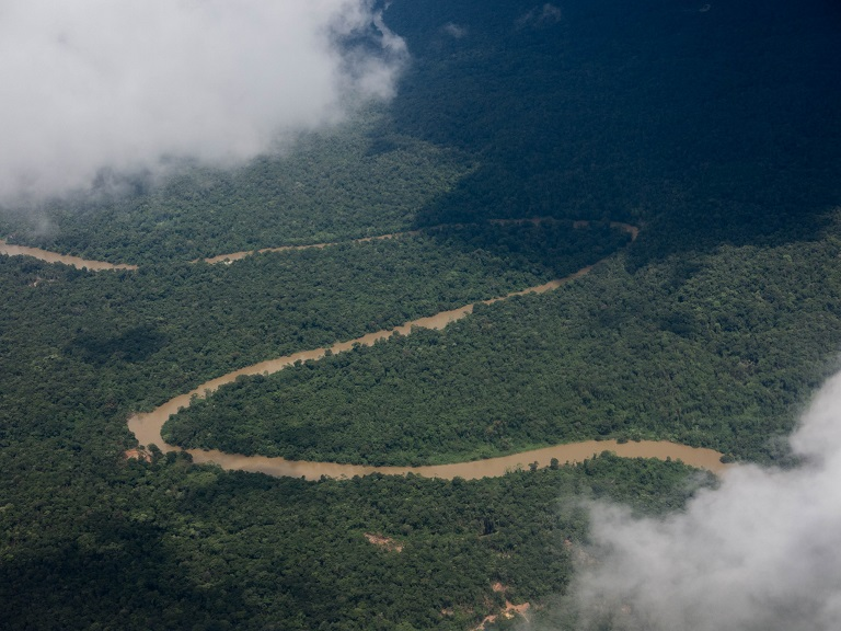 One the many tributaries to the Atrato that snakes through Chocó. Photo by Bram Ebus for Mongabay.
