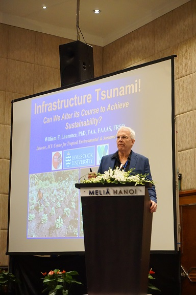 William Laurance of James Cook University delivers the keynote speech at the International Forum on Sustainable Infrastructure at the Melia Hotel in Hanoi. Photo by Michael Tatarski for Mongabay.