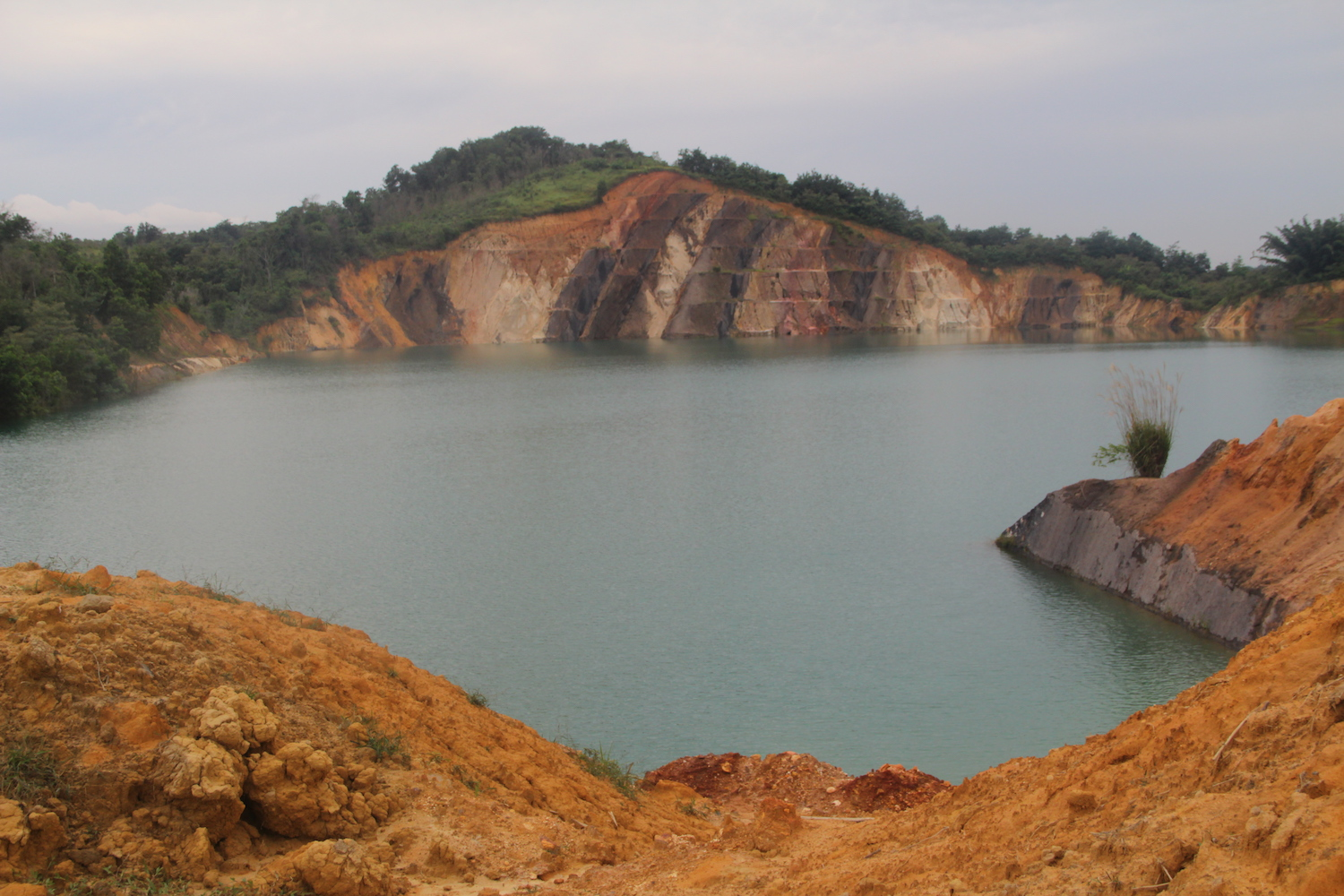 Who owns Indonesia's deadly abandoned coal mines?