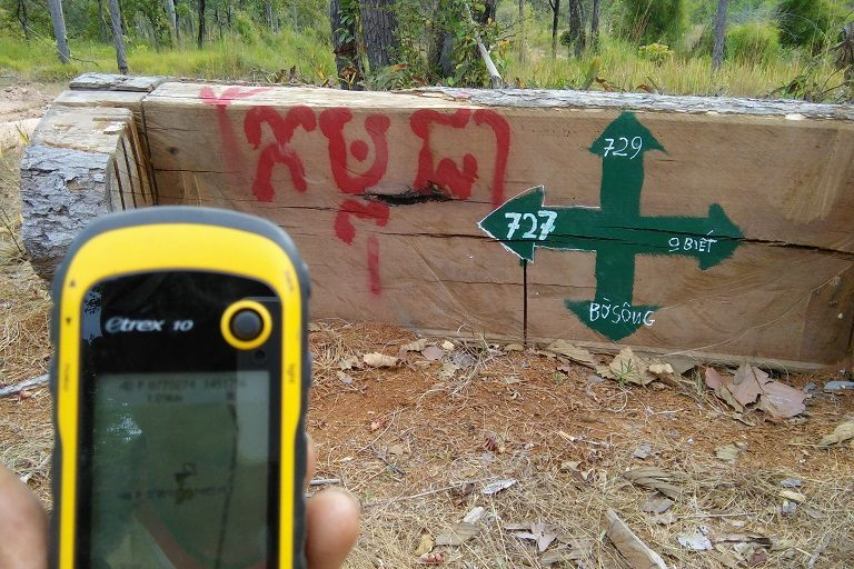 A sign directs logging trucks to timber depots set up along the Vietnamese border with Cambodia. Photo courtesy of EIA.