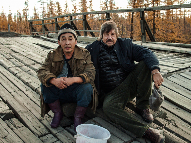 Alex Shoumatoff with a local berry-picker in Verkhoyansk, Siberia, on assignment for Vanity Fair story about how global warming is making more oil available in the Russian Arctic. Photo provided by Alex Shoumatoff.