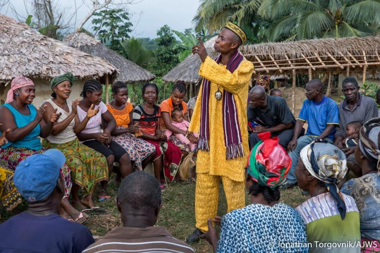 Members of the Jogbjan Clan gather for a community meeting in Grand Bassa, Liberia. The clan has been documenting issues using the TIMBY platform.