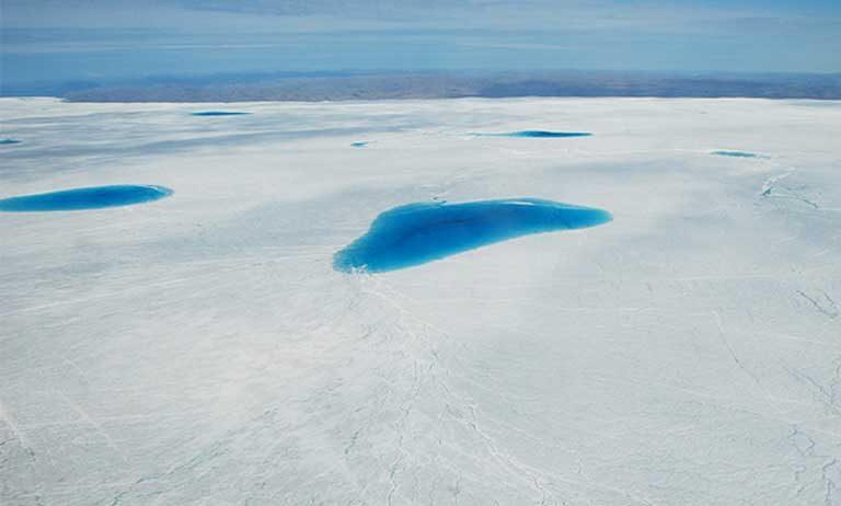 A melt pond atop Greenland's sea ice. Photo by Michael Studinger, NASA GSFC