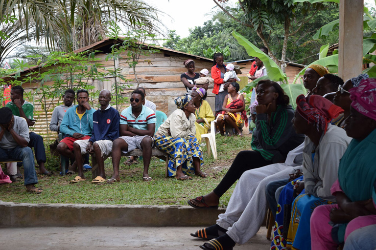 A community meeting near Olam's palm plantations. Some community members work on Olam's plantations, and many have concerns about the operations of the plantations. Courtesy of Mighty
