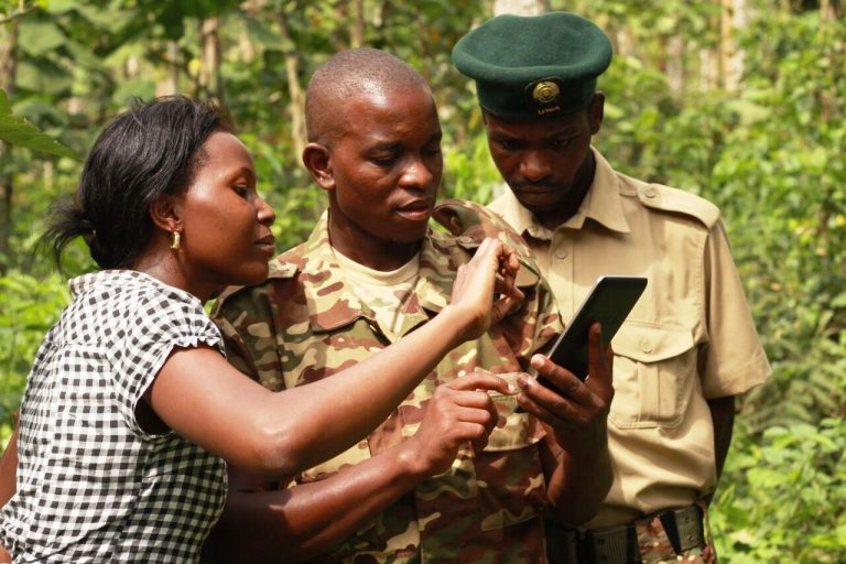 Brenda Mirembe of JGI-Uganda instructs UWA rangers during a training in Kibale National Park.