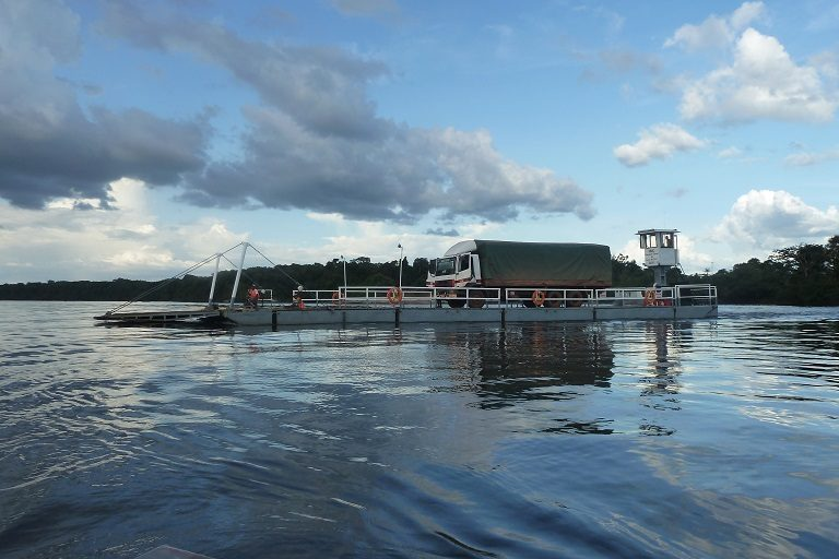 A truck floats on a barge in Guyana. Photo by Carinya Sharples/Mongabay.