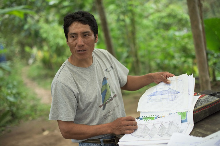 Sergio Basantes shows plans for a new housing lodge on the Mashpi Amagusa Reserve, a family owned property he fought to turn into a bird watching sanctuary. The lodge will be partially constructed with funds from a prize they recently won for their efforts maintaining the area, which is part of the Chocó-Darién rainforest. Photo by Johnny Magdaleno/Mongabay