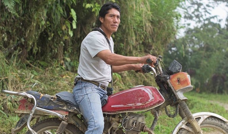 Basantes readies his motorcycle as he prepares to lead a group of tourists to one of the Mashpi Amagusa Reserve's birdwatching areas. Photo by Johnny Magdaleno/Mongabay