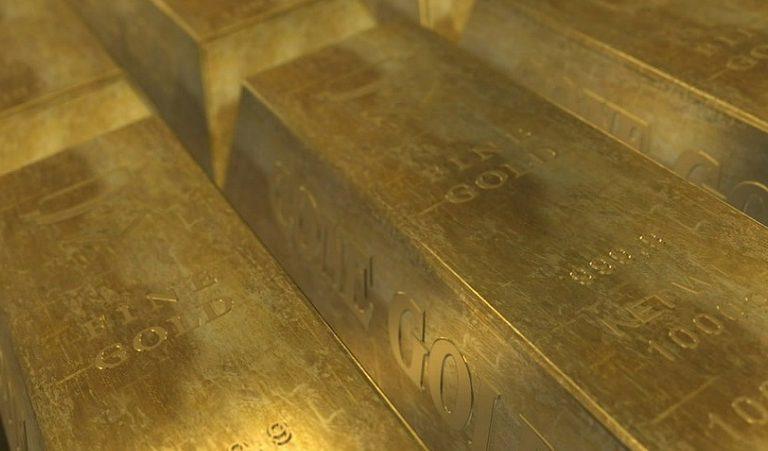 Bricks of processed gold. Photo via Pixabay.