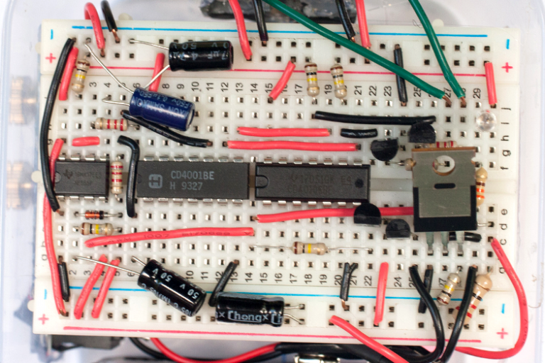 A closeup of the triggering circuit, which can be copied using the rows and columns of the 'breadboard' base.