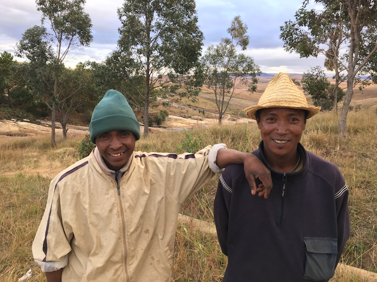 Méthode Andriamerimandamina, left, and Landry Ferdinanrd Ramerina work as patrollers for the community group VOI Sohisika, walking the hills near the Ankafobe forest to keep watch for brush fires during the dry season. Photo by Rowan Moore Gerety for Mongabay.