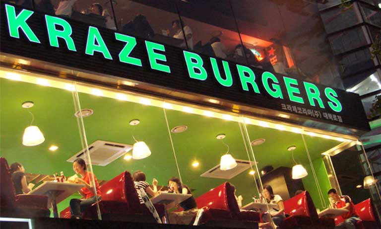 "Kraze Burgers (pronounced ""crazy"") began selling American-style burgers in South Korea in 1988; now they have over 100 stores across the country and have since brought their franchise across the Pacific to the US. In 2007, the US exported 25,000 tons of beef to South Korea; last year that figure reached nearly 180,000 tons. Photo credit: Photocapy/Flickr [Licensed under CC BY-SA 2.0]"