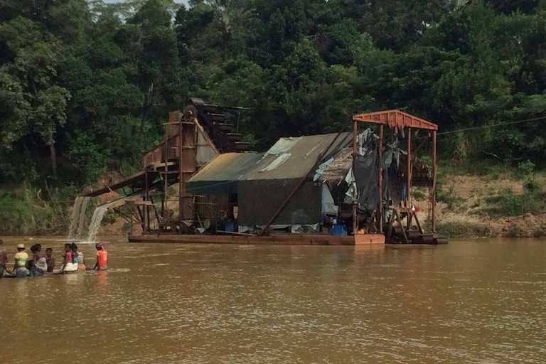 A gold dredge, owned by the Mac Lai Sima Gianna company, dumping tailings into the Itsaka River near the village of Vohilava in southeast Madagascar earlier this month. Much of the region depends on the river for fresh water. Photo courtesy of Anonymous.