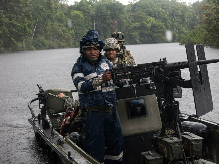 Now Colombia's main guerrilla group demobilized the Armed Forces have more time to go after environmental criminals. Photo by Bram Ebus for Mongabay.