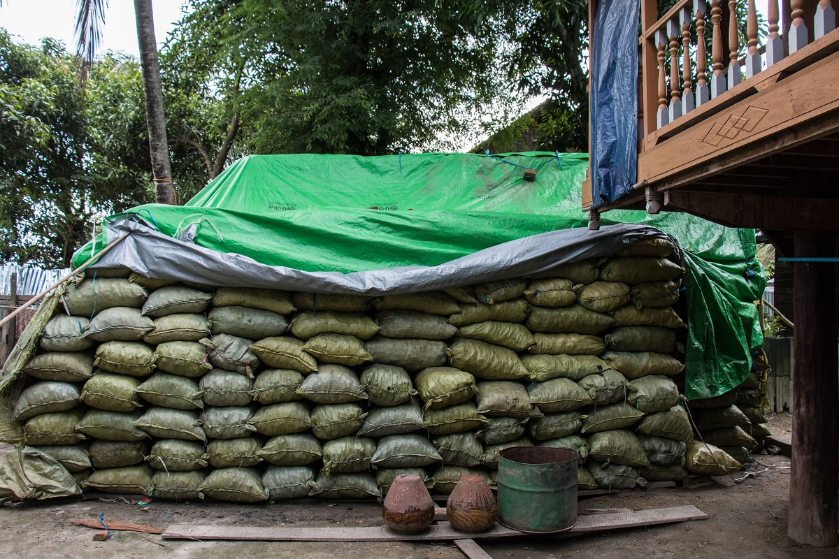 Charcoal bags waiting to be transported near Katha, Myanmar. The charcoal will be sent to Bhamo before going to China. Photo by Nathan Siegel for Mongabay.
