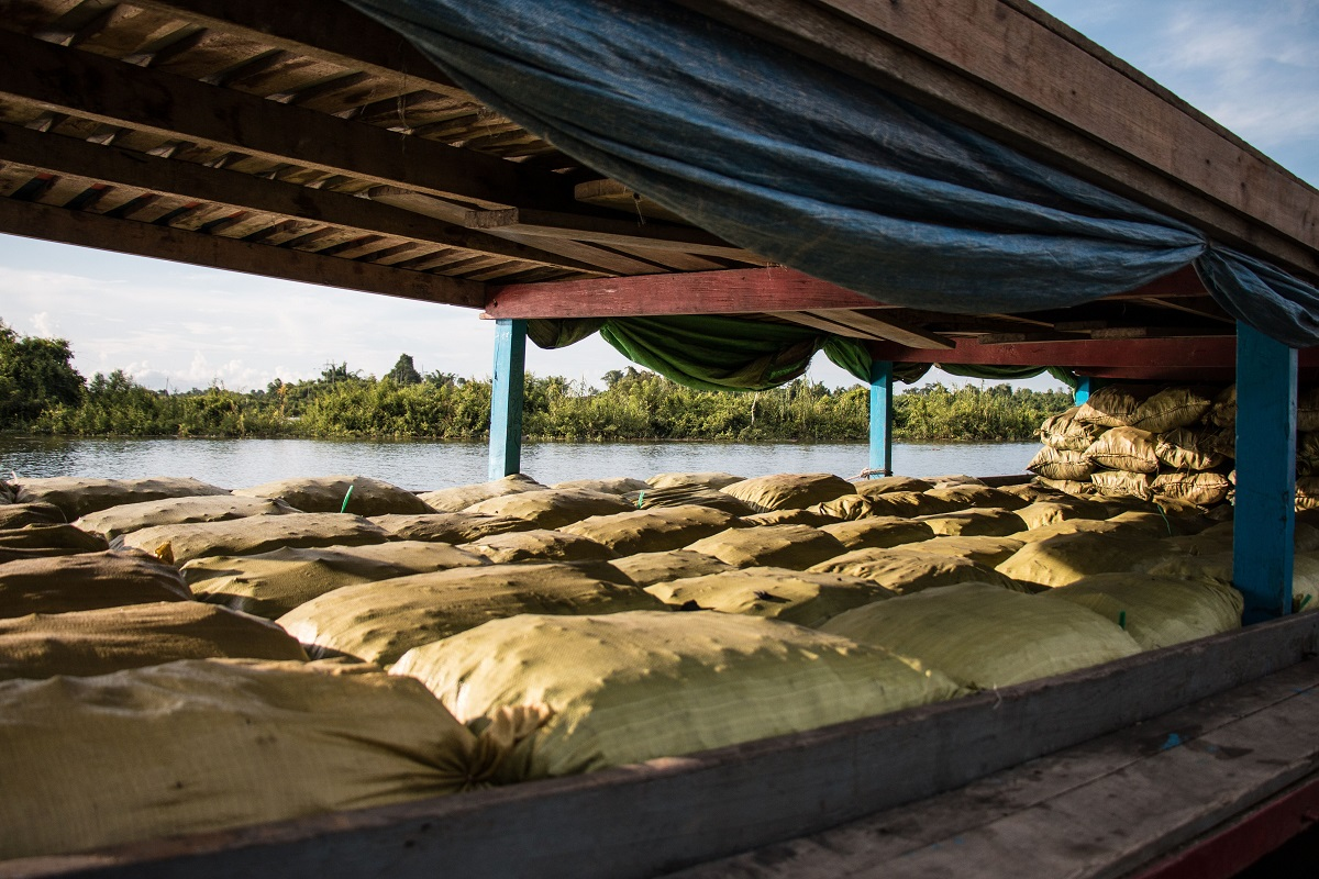 Charcoal bags on a boat near Katha, Myanmar. The boat is bound for Bhamo, where the charcoal will be taken by trucks over the order to China. Photo by Nathan Siegel for Mongabay.