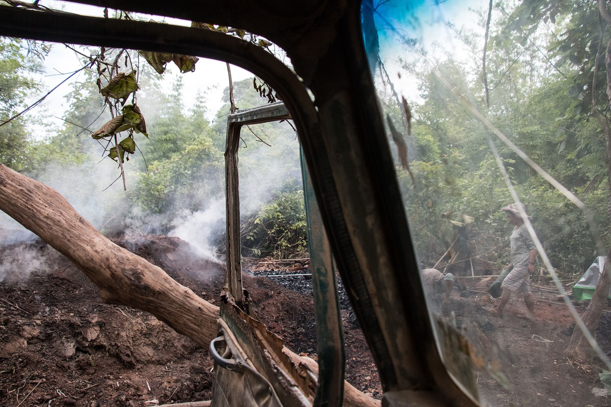 Trucks like this are loaded with charcoal for the 50-mile drive to China. Photo by Nathan Siegel for Mongabay.