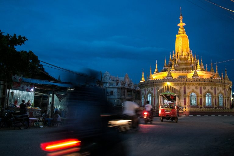 A temple at night in the town of Bhamo, an area greatly influenced by its proximity to the Chinese border. Photo by Nathan Siegel for Mongabay.