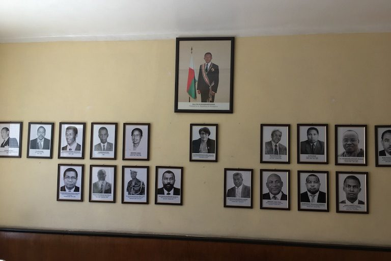 Madagascariscurrentlyonitsninthenvironment ministerinasmanyyears.Alleightofthosepicturedonthebottomrow have served since 2009,aswellascurrentministerJohanitaNdahimananjara,picturedin thecenter. (The large color portrait shows the president, Hery Rajaonarimampianina.) The portraits are on display in the lobby of the a Ministry of the Environment building in the capital city of Antananarivo. Photo by Rowan Moore Gerety for Mongabay.