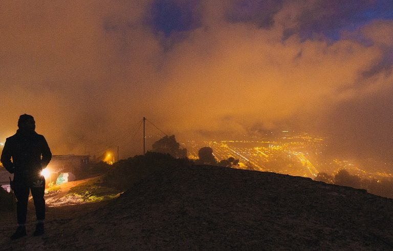 Arley Estupiñan walks towards his house at night. Photo by Ana Cristina Vallejo with permission.