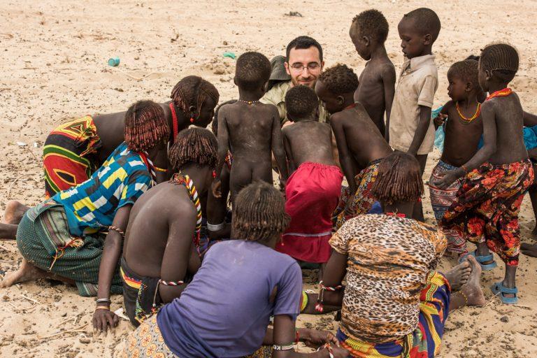 Daasanach storytelling, Sibiloi, Kenya 4, by Joan de la Malla.JPEG  Caption: Dr. Álvaro Fernández-Llamazares connects with multiple generations of Daasanach people in Kenya. Photo by Joan de la Malla.