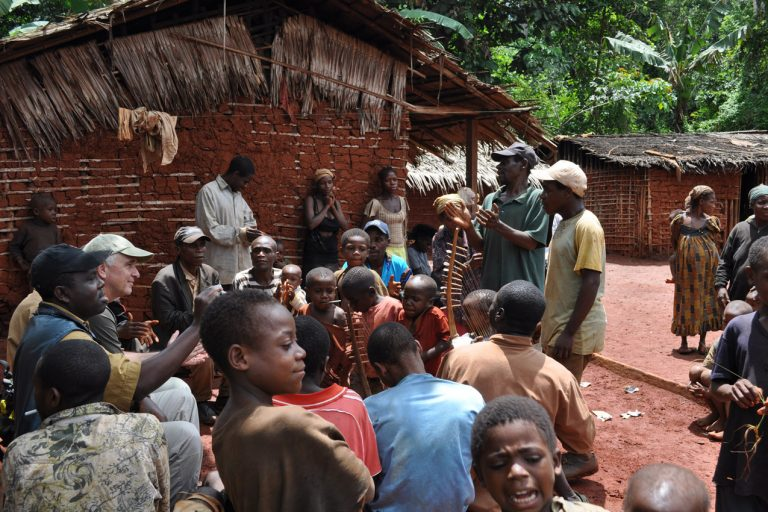 Geographer Tom Smith talks with the Baka in Somalomo village in South Cameroon. Photo by: Trevon Fuller.