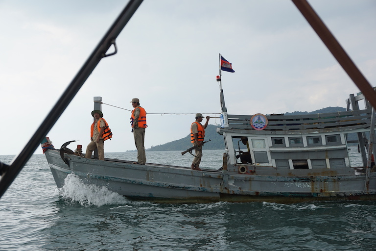 The Cambodian Fisheries Administration out on patrol in Kep Bay, responding to a call from MCC. The administration is a small and under-resourced team fighting against an army of illegal trawlers. Photo by Matt Blomberg.