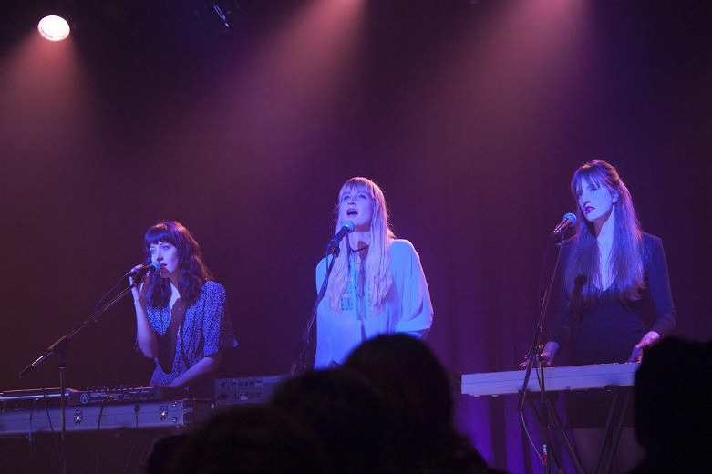 Screenshot photo of Au Revoir Simone, performing in Twin Peaks: The Return. From left: Heather D'Angelo, Erika Spring, and Annie Hart. Photo credit: Showtime