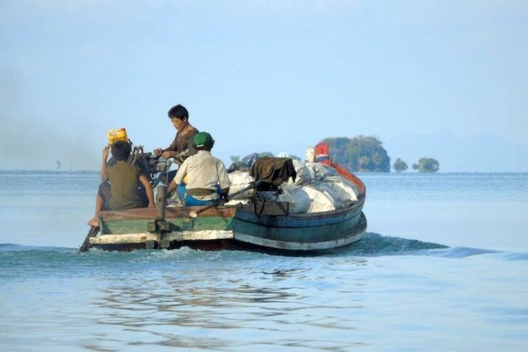 Transporting charcoal made from mangroves in the Myeik Archipelago. Photo by Christoph Zockler.