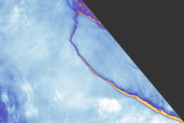 On July 12, 2017, the Landsat 8 satellite's Thermal Infrared Sensor captured this false-color image of iceberg A-68 breaking away from Antarctica's Larsen C ice shelf. Orange shows the warmest areas, particularly the crack between the iceberg and the ice shelf; light blues and whites show the coldest areas, including the nearly 2,240-square-mile (5,800-square-kilometer) iceberg and the ice shelf themselves. Image courtesy of NASA.