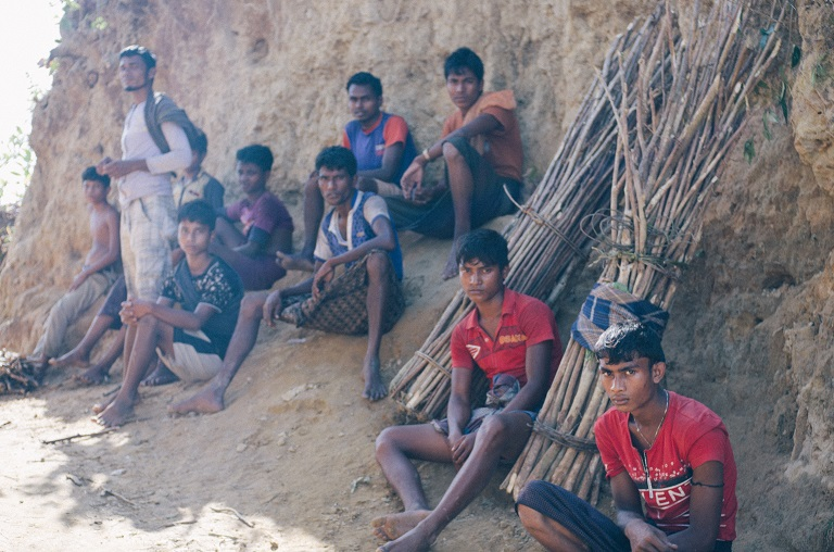 A group of Rohingya men take a break on the long route home from collecting firewood from Bangladeshi forests. Photo by Kaamil Ahmed/Mongabay.