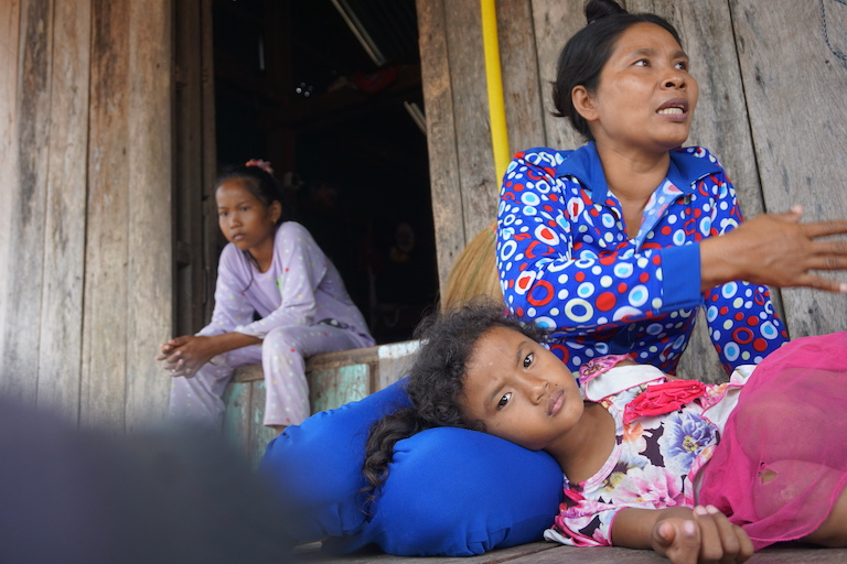 Noa Ye explains how development near Prey Smach has changed life for her family of seven. She said her husband now spends upward of 12 hours a day fishing, more than double the time previously required. Photo by Matt Blomberg for Mongabay.