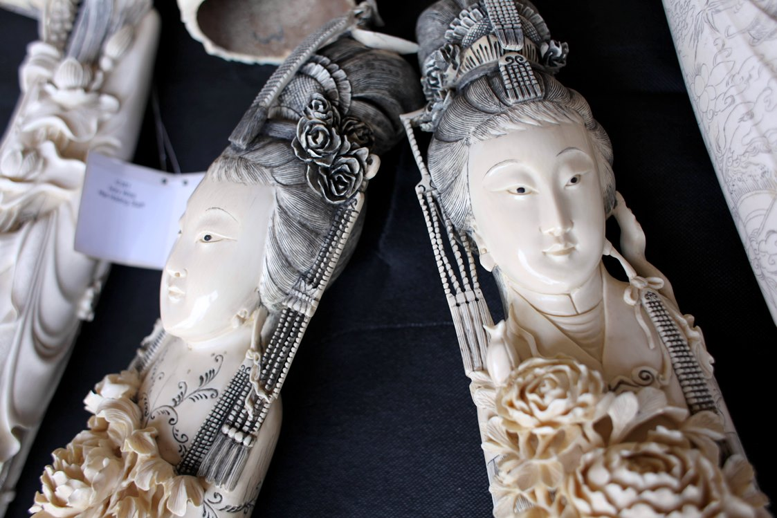 A pair of carved ivory maidens seized in New York city, ready for sampling. They were part of a $4.5 million seizure of illegal ivory from a New York City antiques shop.