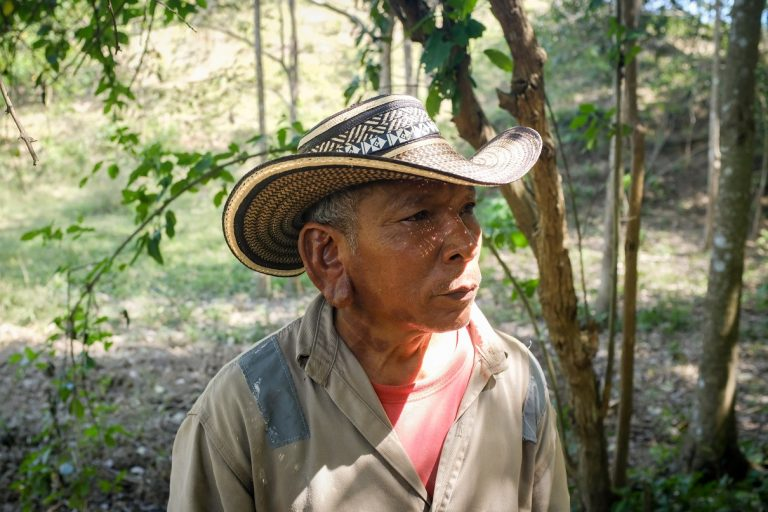Argemiros Capela stands on his lot in front a small patch of forest that has started to grow back after years of desertification, Montes de Maria. Photo by Ana Cristina Vallejo/Mongabay.