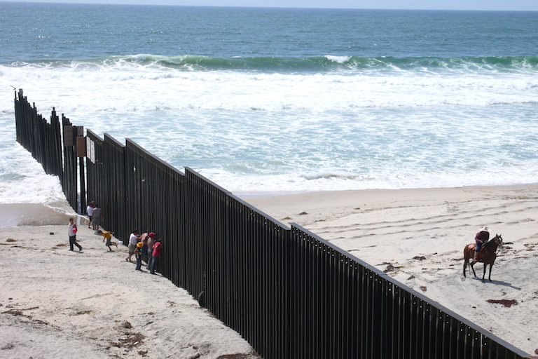 Border infrastructure ends in the Pacific Ocean, between Tijuana, Mexico, and San Diego County, California. Photo by Rurik List.