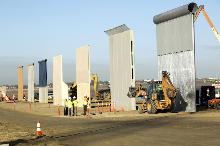 Trump border wall prototypes being built in October, 2017, near the Otay Mesa Port of Entry in San Diego, California. A judge ruled that the U.S. government acted legally in waiving environmental laws to build the prototypes and other wall segments. Photo by Mani Albrecht/U.S. Customs and Border Protection via Flickr.