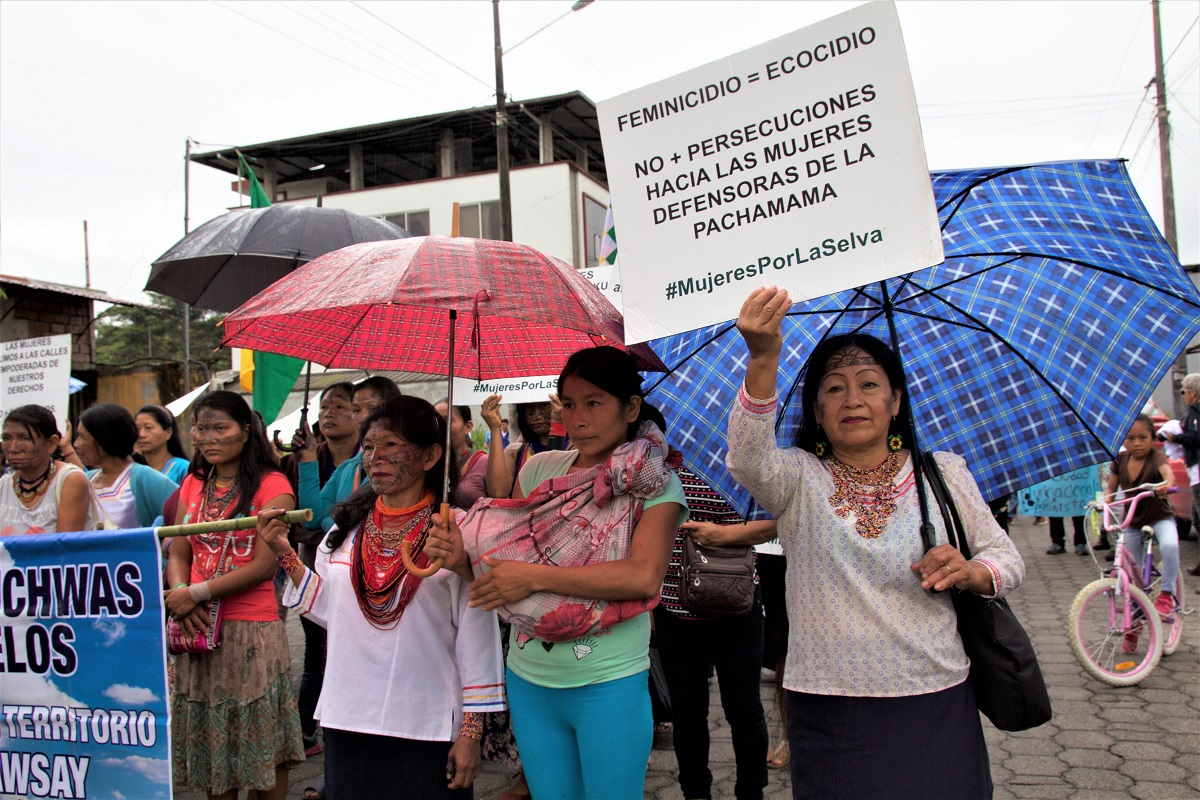 Indigenous women of the Amazonian Quechua community march through the city of Puyo on International Women's Day, holding signs against extractive industries in the Amazon on March 8, 2018. Photo by Kimberley Brown/Mongabay.