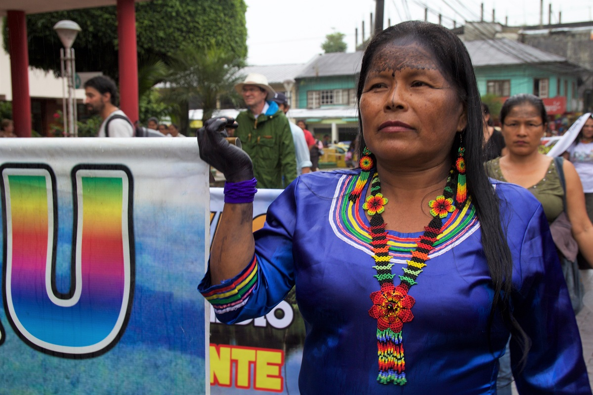 A woman of the Amazonian Quechua community marches through Puyo for the International Women's Day march. Her hands are painted black to protect her from illnesses, March 8, 2018. Photo by Kimberley Brown/Mongabay.